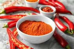 Red chili powder and cut pepper pods stock photos
