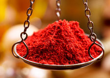 Red chili powder in vintage bowl weights Stock Photo
