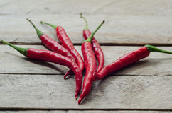 Red chili on an wooden background Royalty Free Stock Photography