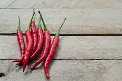 Red chili on an wooden background Royalty Free Stock Image