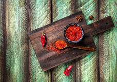 Red Chili on wooden background Stock Image