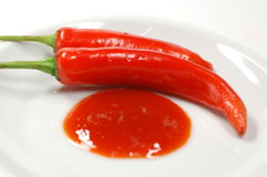 Red Chilies & Sauce Royalty Free Stock Photos