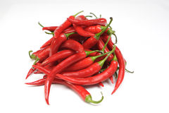 Red chilis. A pile of fresh red chilis, isolated on white background Stock Image