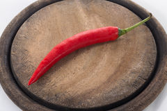 Red chilli on chopping block Royalty Free Stock Photography