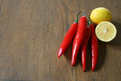 Red chilli and lemon. On wood background Stock Photo