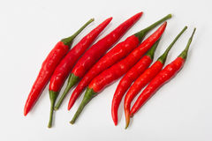 Red chilli. Many red pepper seed on a white background Royalty Free Stock Photos
