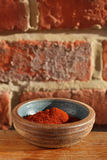 Red chilli paprika powder spice in bowl Royalty Free Stock Image