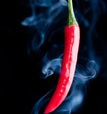 Red chilli pepper with smoke Royalty Free Stock Photography