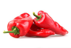 Red chilli peppers. On white background Royalty Free Stock Photos