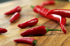 Red chilli peppers. On the Cutting Board Stock Photo