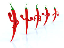 Red chilli peppers with arms Stock Photos