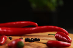 Red chilli peppers. On the Cutting Board Stock Photos