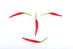 Red chilli peppers isolated on white Royalty Free Stock Image