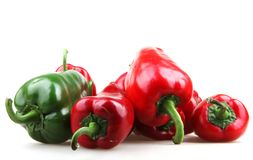 Red chilli peppers on white background. Red chilli peppers isolated on white background Royalty Free Stock Image