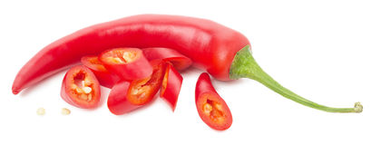 Red chilli peppers with slices isolated on the white background stock photo