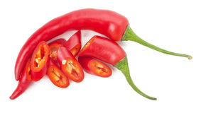 Red chilli peppers with slices isolated on the white background Royalty Free Stock Photos