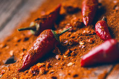 Red chilli peppers, spicy on a wooden spoon. Vegetable on a dark, wooden table. Concept of hot food. Royalty Free Stock Photography