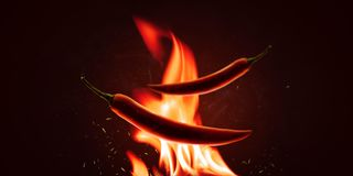 Free Red Chilli Peppers With A Powder On A Fire Element And Hot Background. Spicy Food And Burning Concept. Explosion Of Paprika Chili Stock Photos - 160264823