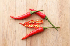 Red chilli peppers on wooden background Royalty Free Stock Photography
