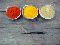 Red chilli, turmeric and coriander powder. Indian spices red chilli, turmeric and coriander powder royalty free stock photography