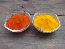 Red chilli and turmeric powder in the bowl. Indian spices red chilli and turmeric powder in the bowl Royalty Free Stock Photo