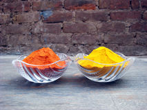 Red chilli and turmeric powder in the crystal bowl. Indian spices red chilli and turmeric powder in the crystal bowl royalty free stock images