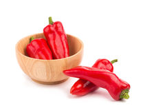 red chilli vegetable in Wooden bowl Isolated on white background Royalty Free Stock Photography