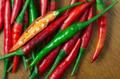 Red chilli on wood background Stock Photos
