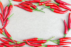 Red chilli on wooden table background. Royalty Free Stock Photo