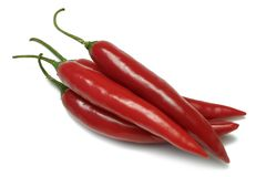 Red Chillies. Four Red Chillies isolated on white Royalty Free Stock Images