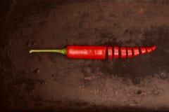 Red chillies. On a dark underground Royalty Free Stock Photos