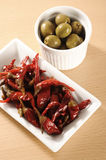 Red Chillies and Olives. On wooden table stock images