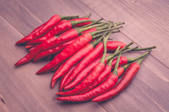 Red chillies pepper on the wooden floor Royalty Free Stock Photo