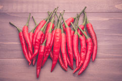 Red chillies pepper on the wooden floor Royalty Free Stock Images