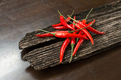 Red chillies on a plank Stock Photography