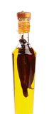 Red chillies preserved in a bottle of olive oil. Stock Photo