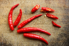 Red chillies and slices Royalty Free Stock Photos