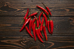 Red chillies on wood background. Red hot chillies on wood background Stock Image