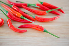 Red Chillis on wooden top Royalty Free Stock Images