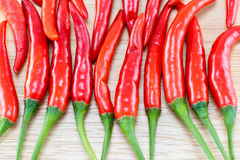Red Chillis on wooden top Stock Image