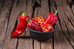 Red chilly pepper on wooden black background. Red hot chili pepp Royalty Free Stock Photos