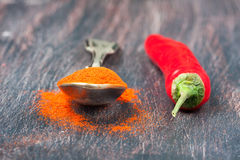 Red chilly peppers  on a wooden table Royalty Free Stock Image