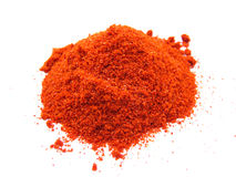 Red Chilly Powder. Pile of spicy red chilly powder isolated on white stock images
