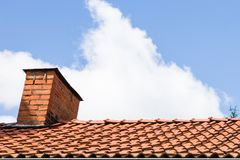 Red Chimney with Tiles and Blue Cloudy Sky Royalty Free Stock Photo