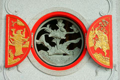 Red Chinese circular windows. Chinese circular window decorated with stone sculpture Stock Image