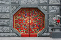 Red Chinese Door. Traditional Chinese style door at a temple. This door has eight sides and is red in color.  It is decorated in traditional Chinese style Royalty Free Stock Photography