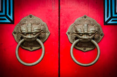 Red chinese door. With a lion/dragon head Royalty Free Stock Photography