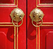 Red chinese door with a lion head. royalty free stock photos