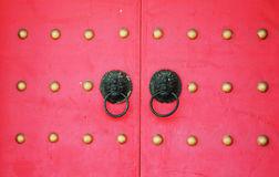 Red chinese door with old doorknob Royalty Free Stock Image