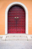 Red chinese door. Red traditional chinese door with arch gateway Royalty Free Stock Photography